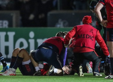 Murray is treated on the pitch against Glasgow.