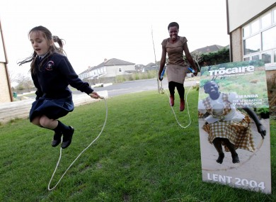 Josiane recreating the photograph on the 2004 Trócaire box with a pupil from a Dublin school.