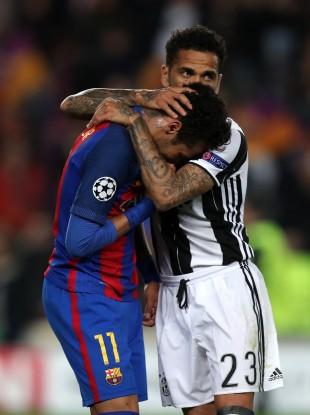 Juventus' Dani Alves (right) commiserates with Barcelona's Neymar.