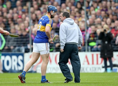 Davy Fitzgerald clashes with Tipperary hurler Jason Forde.