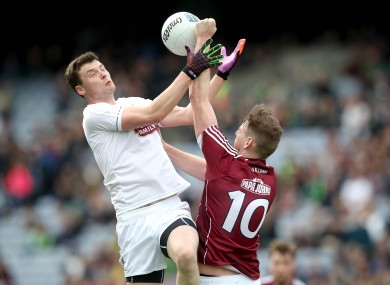 Kildare's Fionn Dowling and Galway's Thomas Flynn battle for possession.