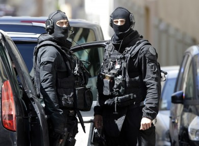 Police officers outside an address in Marseille.