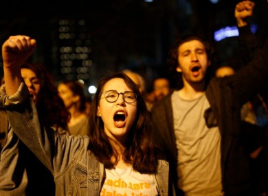 Supporters of No vote chant slogans as they protest against the referendum outcome, in Istanbul early today