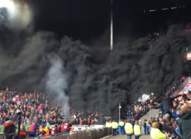 Smoke pours from the stand.