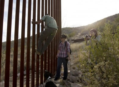 Tim Foley shows how to climb a section of the border wall separating Mexico and the United States.