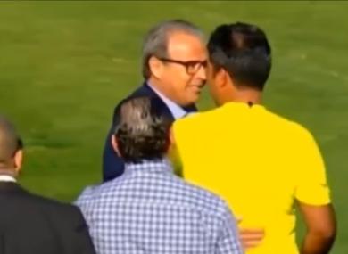 Club Sfaxien President Moncef Khemakhem confronts the linesman.