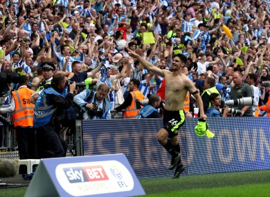 Huddersfield Town's Christopher Schindler celebrates winning the penalty shoot-out.
