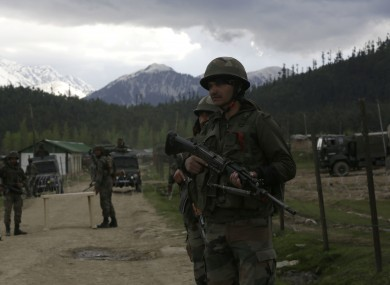 File photo of Indian army soldiers guarding a military camp in Kashmir.