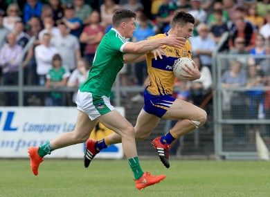 Clare's Jamie Malone and Ian Corbett of Limerick.