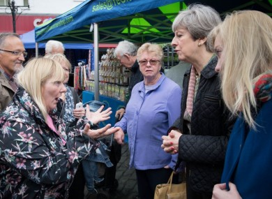 Prime Minister Theresa May meets Cathy Mohan at Abingdon market in Oxfordshire