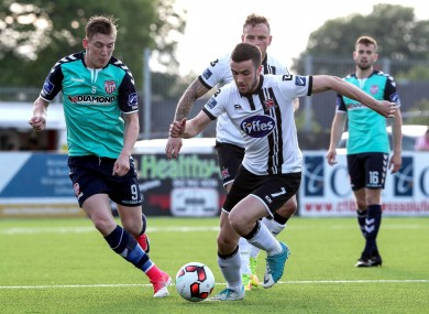 Dundalk's Michael Duffy under pressure from Ronan Curtis of Derry City.
