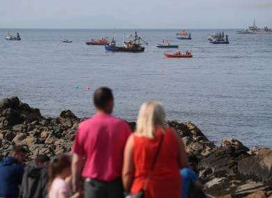 Onlookers as the search persisted into the evening at Skerries harbour yesterday