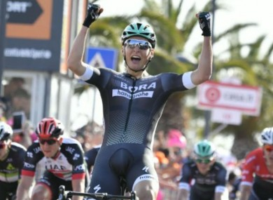 Lukas Postlberger celebrates winning the opening stage of the Giro d'Italia