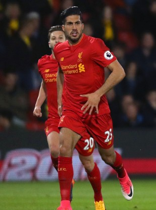 Emre Can celebrates after scoring for Liverpool against Watford.