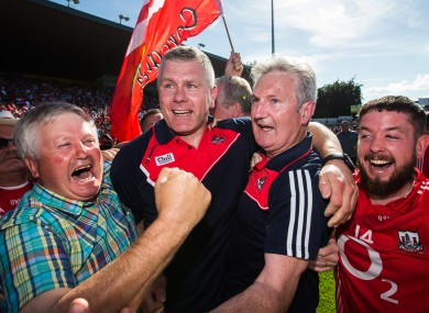 Kieran Kingston and Diarmuid O'Sullivan celebrate Cork's victory.