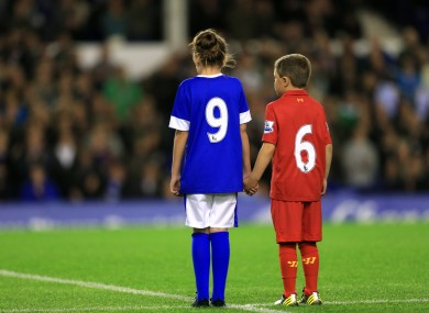 A young Everton and Liverpool fan pay tribute to the 96 people who died in the Hillsborough tragedy.