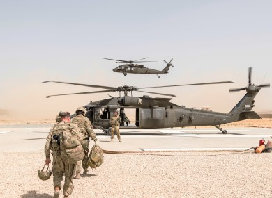 A U.S. Army UH-60 Black Hawk helicopter crew chief assigned to Task Force Griffin, 16th Combat Aviation Brigade in Kunduz.