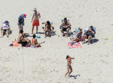 Governor Chris Christie, right, uses the beach with his family and friends at the governor's summer house at Island Beach State Park in New Jersey.