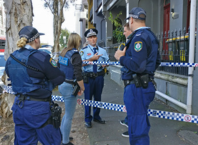 Police officers outside an address as part of counter terror raids in Sydney