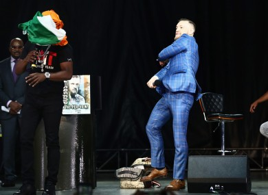 McGregor throws the Irish flag at Mayweather.