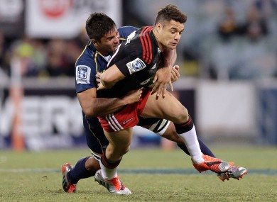 Butler seen here tackling Dan Carter.