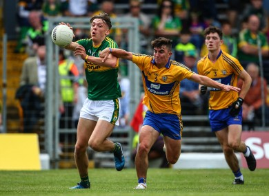 Kerry captain David Clifford in action against Clare's Sean Rouine.
