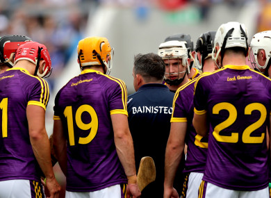 Davy Fitzgerald and his Wexford players before yesterday's game.