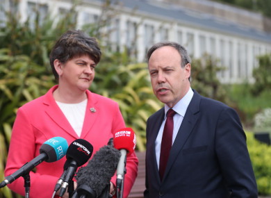 DUP leader Arlene Foster and Nigel Dodds speak to the media at Stormont Castle in Belfast.