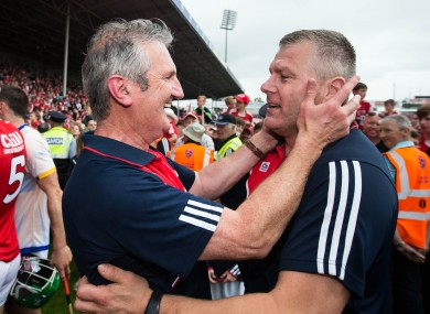 Diarmuid O'Sullivan celebrates Cork's victory with Kieran Kingston.
