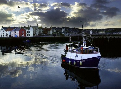 A trawler bringing in its catch at Eyemouth harbour, in the Scottish Borders.