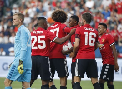 Man United celebrate Rashford's second goal.