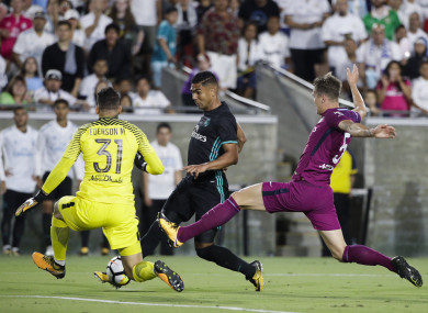 Ederson saves from Real Madrid midfielder Casemiro.
