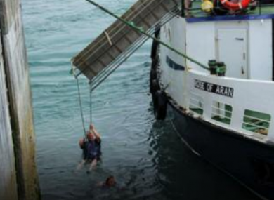 A man being rescued from the sea at Inis Oirr harbour on June 6, 2016.
