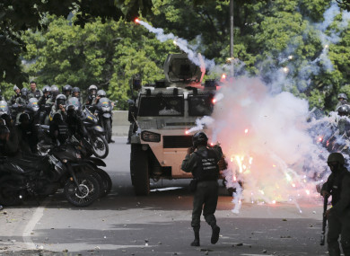 Protesters clash with security forces in the Venezuelan capital, Caracas