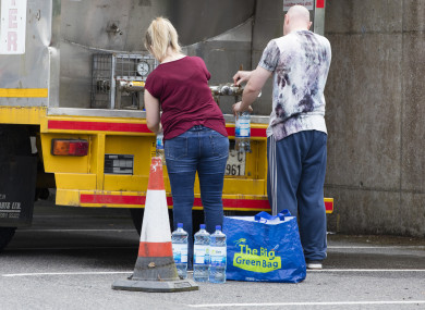 Residents fill up from a water truck in a supermarket car park in Ratoath, Co Meath.