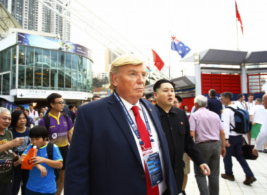 Men in masks of Donald Trump and Kim Jong-Un