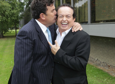 Presenter Des Cahill kisses his colleague Marty Morrissey.