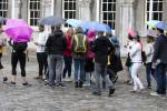 Tourists in the rain in Dublin Castle.