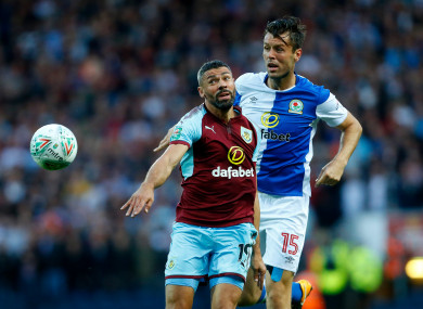 Blackburn's Elliott Ward in action with Burnley's Jonathan Walters (left).