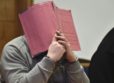 Niels Hoegel hides his face during a court hearing in 2015.