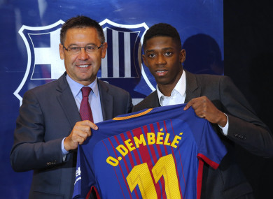 Barcelona's new signing player Ousmane Dembele, right, and FC Barcelona's president Josep Maria Bartomeu pose for the media during official presentation at the Camp Nou stadium.