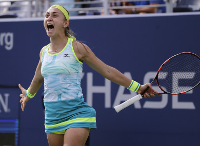 Aleksandra Krunic, of Serbia, reacts after beating Johanna Konta, of Great Britain.