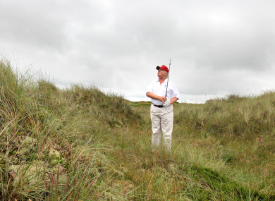 Donald Trump plays golf at his course in Aberdeen.