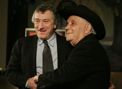 Robert DeNiro and boxer Jake LaMotta stand for photographers before watching a 25th anniversary screening of the movie Raging Bull in New York in 2005.