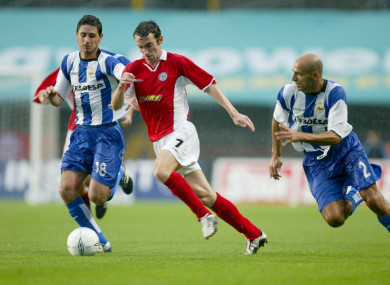 Shelbourne's Ollie Cahill with Manuel Garcia and Victor Sanchez of Deportivo in 2004.