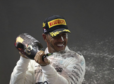 Mercedes driver Lewis Hamilton of Britain celebrates after winning the Singapore Formula One Grand Prix.