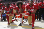 San Francisco 49ers Eli Harold (58), quarterback Colin Kaepernick (7) and Eric Reid (35) kneel during the national anthem before their NFL game against the Dallas Cowboys.