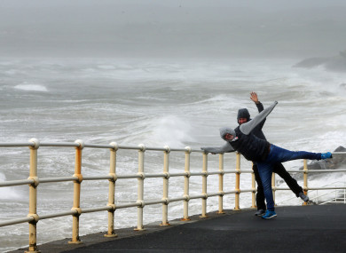 People battle yesterday's winds in Lahinch, Co Clare.