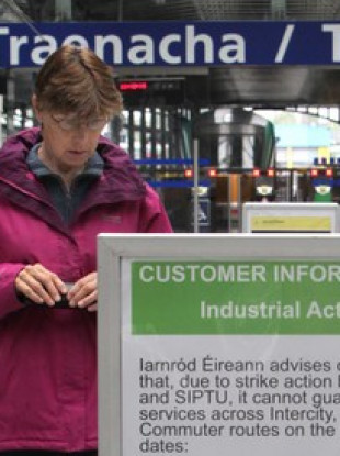 File photo: Woman finding out that there's no train service over strike action in 2014