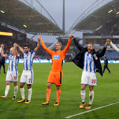 Huddersfield Town's players celebrate after the final whistle.